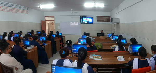 Young men and women learning computers