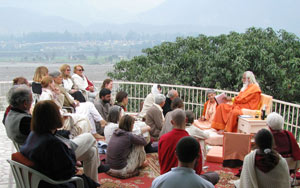Swamiji and devotees sitting on the terrace during morning satsang